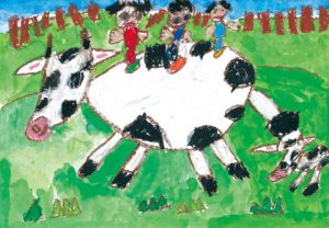 牧場で牛にのったよ!